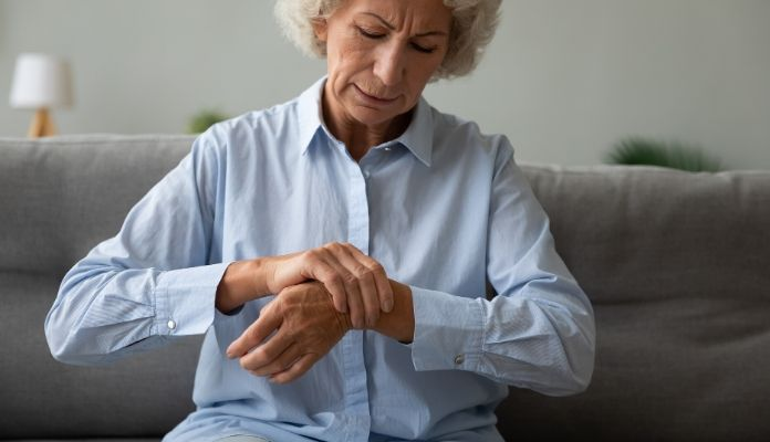 Applying ointment to relief joint pain