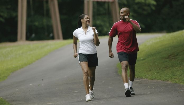Couple brisk walking in the park