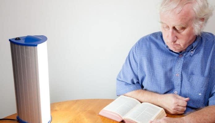 Man reading with SAD lamp